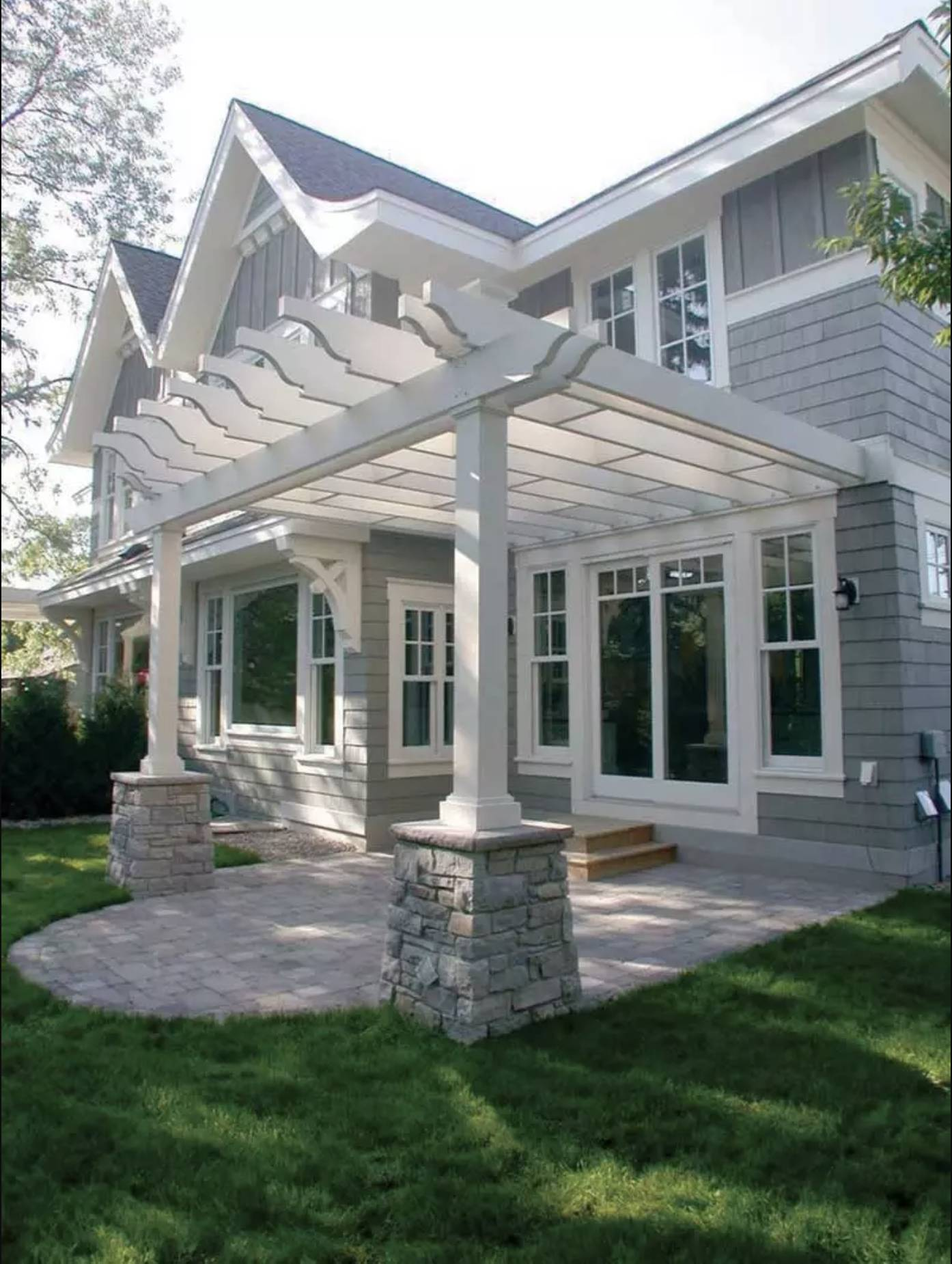 White Pergola with Grey Stone Accents