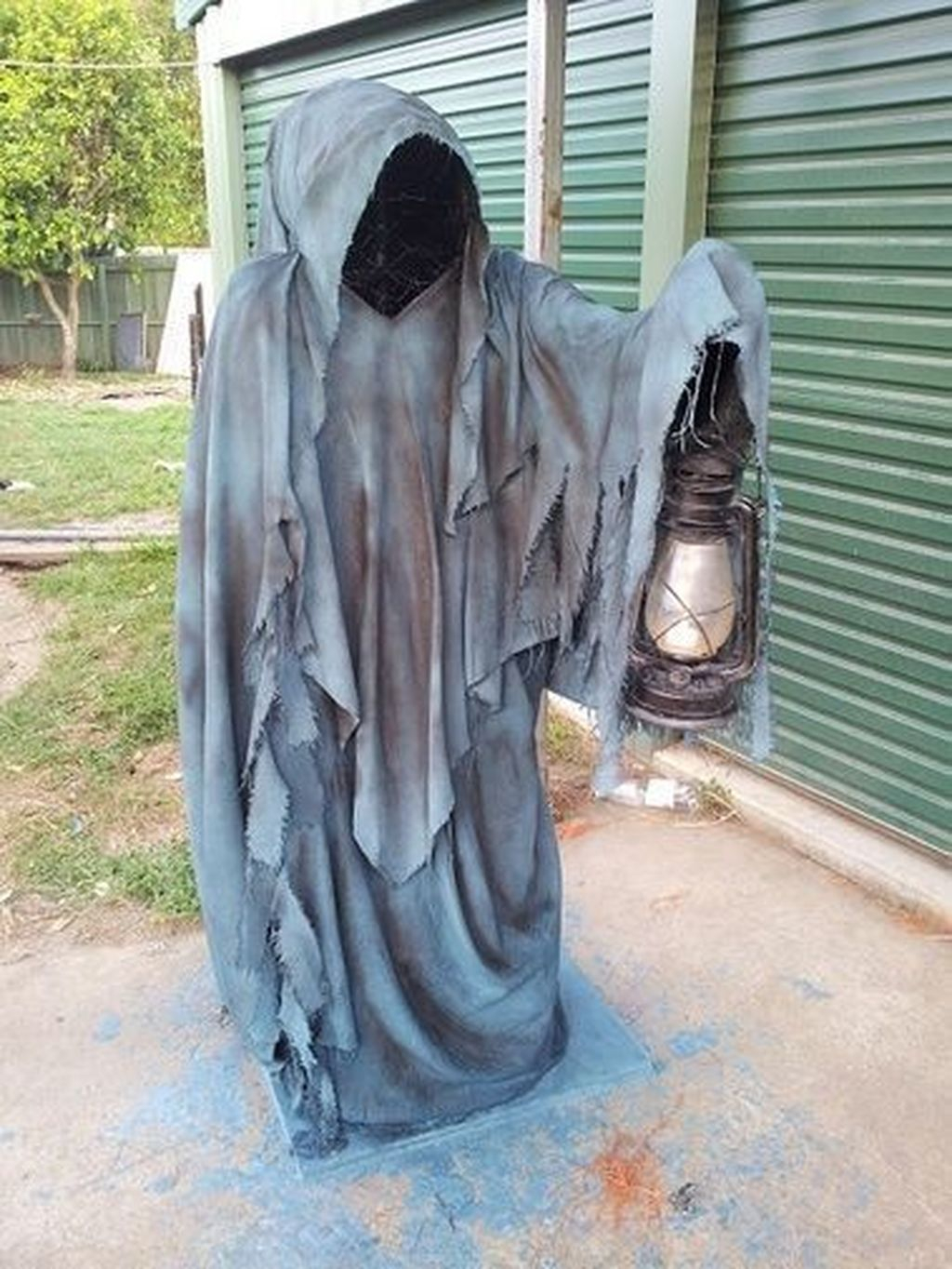Faceless Ghost Sculpture with Hanging Lantern
