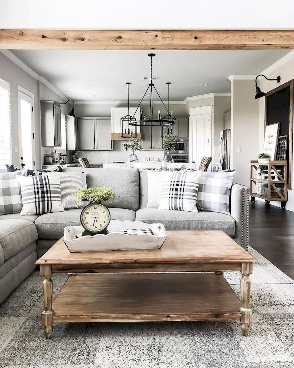 Cozy Farmhouse Living Room with Minimalist Chandelier